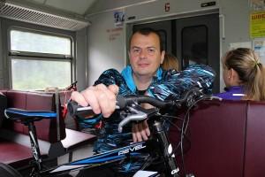 В электричке с велосипедом