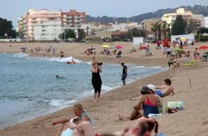 Фотограф на пляже Costa Brava