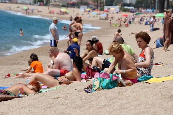 Отдыхающие на пляже Costa Brava