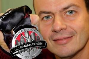 С медалью финишера worldrun.online