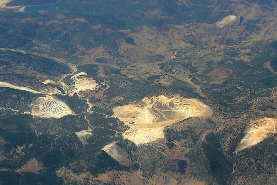 Карьерами изрыты горы
